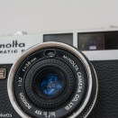 Minolta Hi-Matic F 35mm rangefinder camera showing light cell and film speed settings