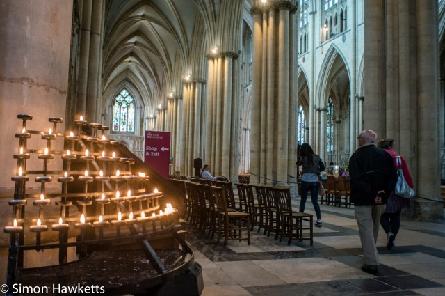 Inside York Minster with burning candles