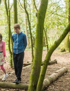 Beningborough Hall pictures - A boy and girl walking and talking in the forest