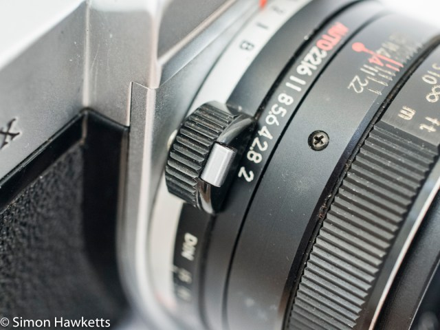 Shutter speed adjust with film speed pull out lever