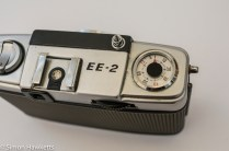 Olympus Pen EE-2 half frame 35mm camera showing shutter button, wind on thumb wheel and frame counter