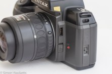 Pentax SF10 35mm slr showing MF/AF switch, cable release socket and flash release button