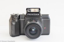 Pentax SF10 35mm slr showing the flash up and the focus assist light