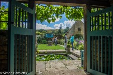 Looking through a door into the garden at Snowshill Manor