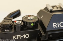 Ricoh KR-10 35mm SLR showing shutter speed lock button