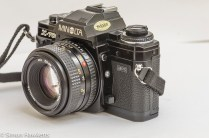 Minolta X-700 35mm slr side view of lens release and DOF preview