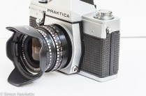 Praktica Super TL3 35mm single lens reflex camera side view showing sync socket