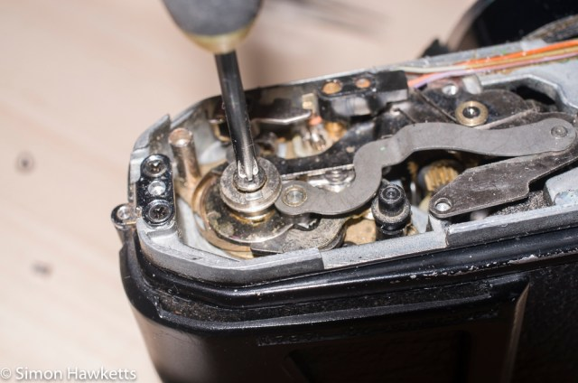 Repairing a Pentax ME - Loosening the screw in the centre of the motor drive shaft