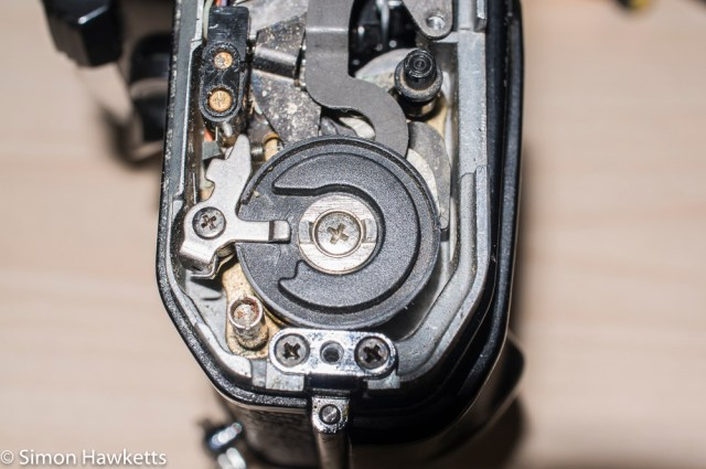 Repairing a Pentax ME - The plastic disk over the motor drive on a Pentax Super Program