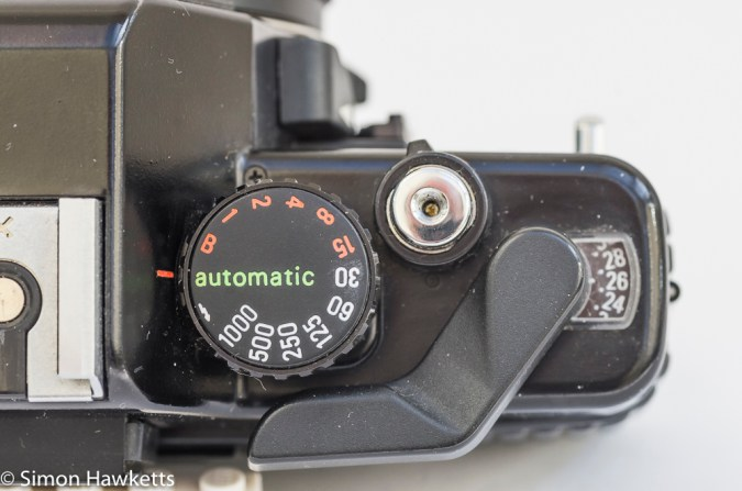 Detail shot of the Praktica B200 shutter speed/mode dial, shutter release and lock, frame counter and film advance