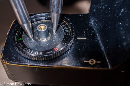 Ricoh singlex TLS strip down and repair - remove the nut under the rewind knob