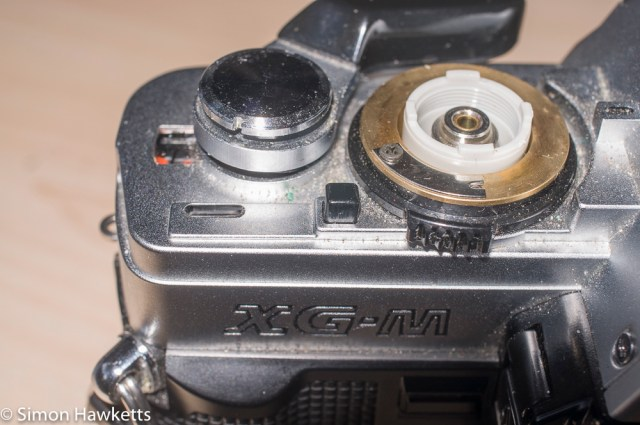 Minolta XG-M repair - unscrew the top of the film advance