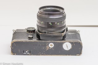 Ricoh Singlex TLS 35mm single lens reflex camera showing tripod bush and battery compartment