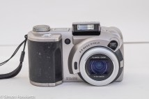 Fuji MX-2900 compact camera - front view of camera with flash extended