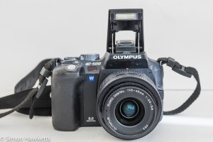 Olympus E500 dslr - front view with flash raised