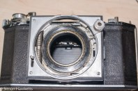 Agfa Karat 12 re-assembly - front decorative cover re-fitted