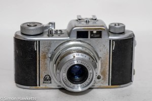 Aka Relle 35mm interchangeable lens viewfinder camera - front view of rather battered camera