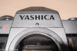 Yashica TL Elextro X repairs - screw above lens mount.