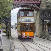 Crich tramway museum - Glasgow co-op passing under the bridge