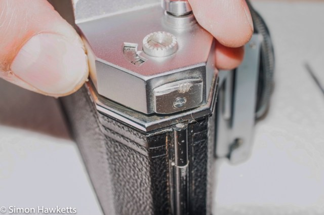 Agfa Karat IV film transport - top cover retaining screw (pull back film advance to get to this)