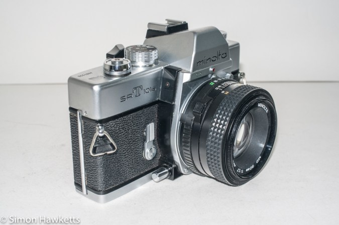 Minolta SRT101b 35mm slr camera - side view showing DOF switch and self timer