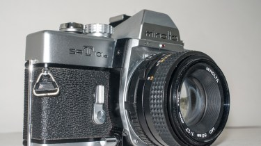 Minolta SRT101b 35mm slr camera - side view with 50mm f/1.7 lens