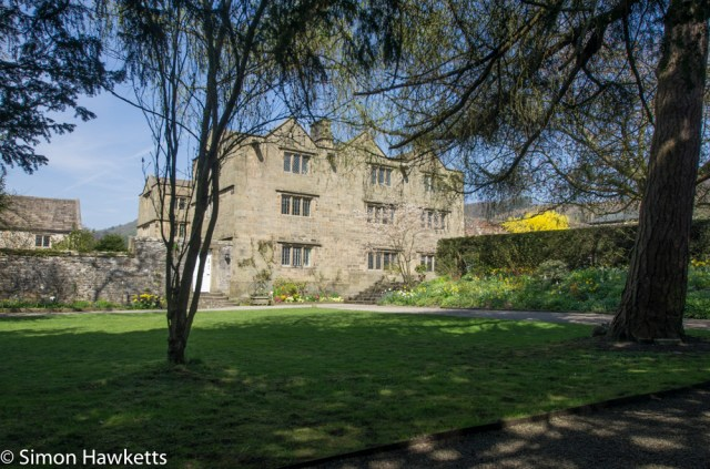 Eyam Hall Pictures - Eyam hall through the trees