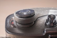 Stripping down a Beauty Beaumat - removing film advance retaining nut