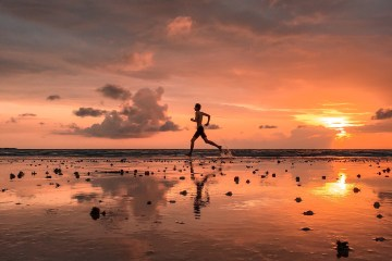 Running on a beach at sunset