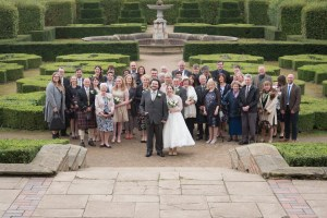 Wedding group in a country house hedge garden