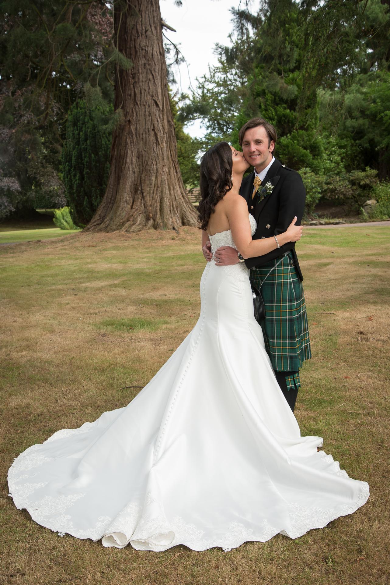Beautiful wedding dress and kilt at Huntingtower Hotel