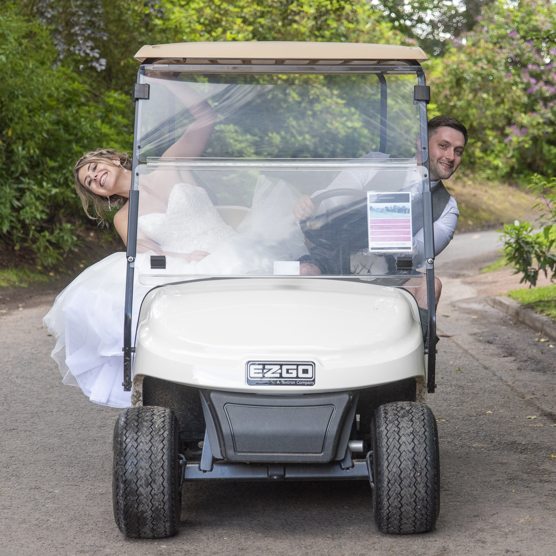Daniel and Kellie in golf buggy