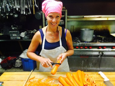 Prepping fresh carrots for a salad in our kitchen