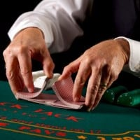 A dealer in a casino is shuffling cards on the picture. Shuffle tracking is one of the methods used to make money gambling by eliminating the house edge. You can read about shuffle tracking to the right of the picture. The picture also acts as a link, by clicking on it you will be taken to a webpage with a tutorial, (video tutorial included) that will teaches you shuffle tracking, shuffle tracking strategy and techniques.