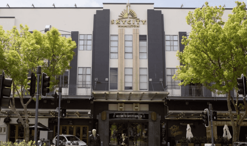 This is a picture of the building and front gate of SkyCity Hamilton, one of the 6 casinos in New Zealand. On this page you can read about the taxation, legislation, licensing of casino gambling in New Zealand, and you can find a list of licensed casino gambling establishments, slot halls and online casinos, which accept NZ players.