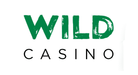 """This is the header image of Wild Casino casino review. The picture consists of the words """"WILD"""" and """"CASINO"""" over a white background. """"WILD"""" is written in green all caps letters and """"CASINO"""" is written in black all caps letters. This is the alternate version of the logo of the company, used with permission. You can read the review of Wildcasino under the picture."""