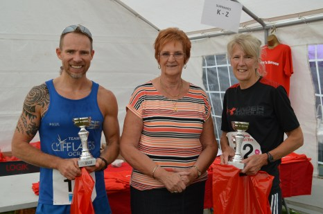1st male 5K finisher, Paul Furness and 1st female 5K finisher Rachael Eastland pictured with Barbara Abbott.