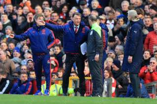 GOING: Man Utd manager Louis van Gaal complains to fourth official Mike Dean
