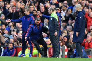 GOING: Man Utd manager Louis van Gaal imitates a dive in front of fourth official Mike Dean