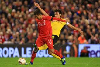 Roberto Firmino of Liverpool battles with Mats Hummels of Dortmund