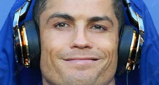 Cristiano Ronaldo smiles before the match