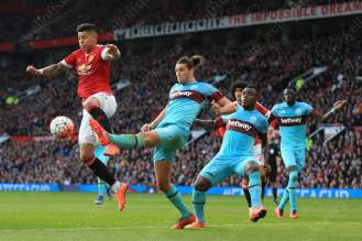 Marcos Rojo of Man Utd battles with Andy Carroll of West Ham during their Barclays Premier League clash