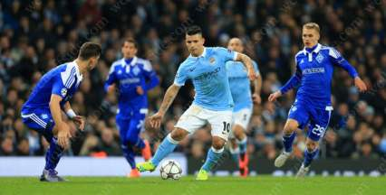 Sergio Aguero looks to liven the match up for Man City