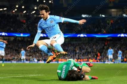 David Silva of Man City leaps over Kiev goalkeeper Oleksandr Shovkovskiy during their UEFA Champions League bore-draw