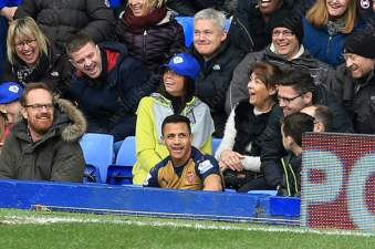 Alexis Sanchez of Arsenal ends up amongst the Everton fans at Goodison