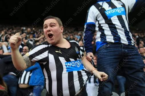 Newcastle fans celebrate their late equaliser against Sunderland