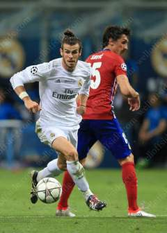 Gareth Bale of Real skips past Stefan Savic of Atletico