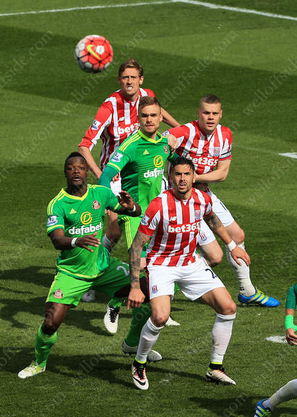Geoff Cameron of Stoke and Lamine Kone of Sunderland watch the ball as it floats into the box