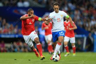 Roman Shirokov of Russia battles with Ashley Williams of Wales