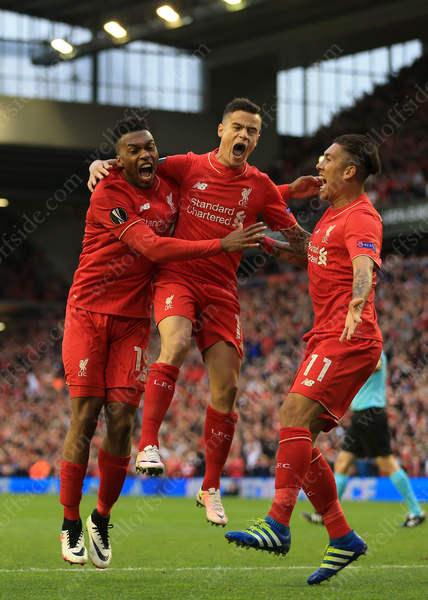Liverpool players Daniel Sturridge (L), Philippe Coutinho (C) and Roberto Firmino (R) celebrate their 1st goal